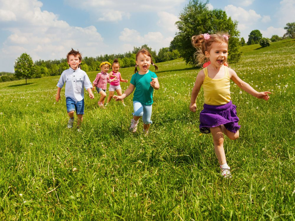 Toddlers running in the park near Juniors Day Nursery.
